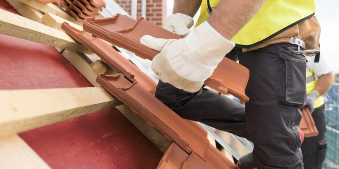 Urban roofers roof installation with Alegra roof tiles wearing safety gloves and safety jackets